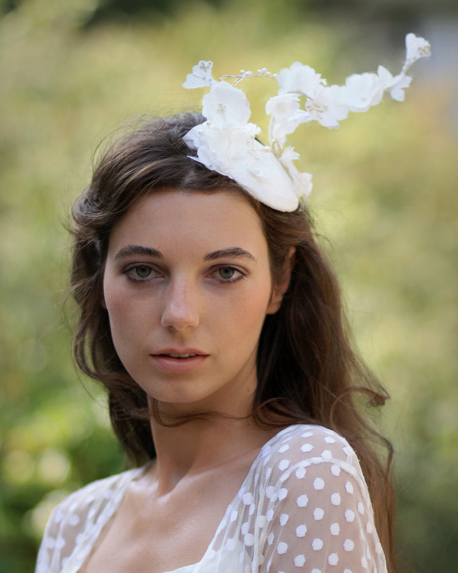 Statement bridal birdcage fascinator with veil with silk ivory flowers and dotted veil
