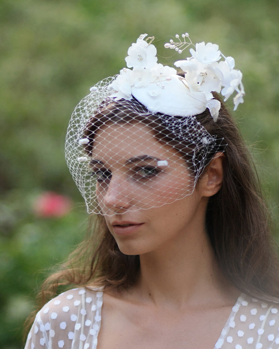 Statement bridal flower birdcage veil hat with silk ivory flowers and dotted veil