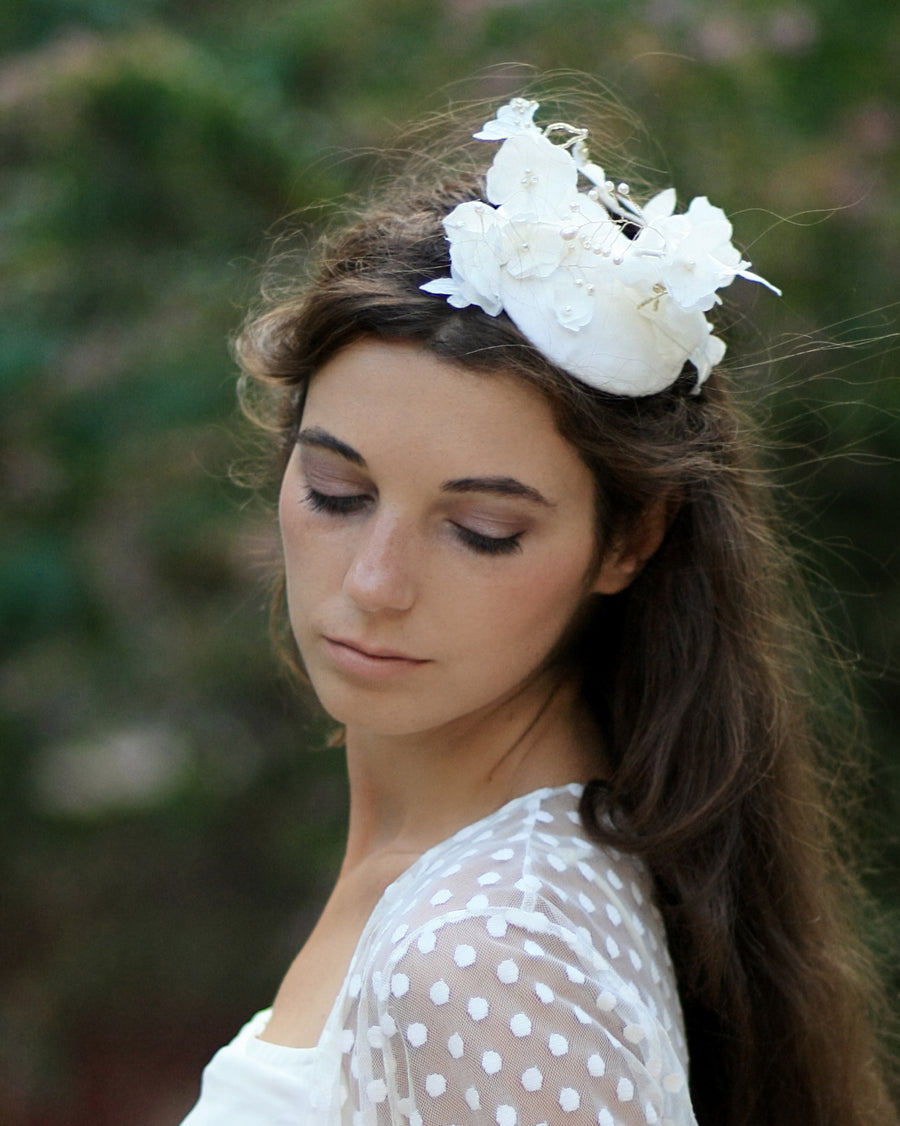 Statement bridal flower birdcage fascinator hat with silk ivory flowers and dotted veil