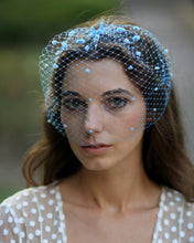 Whimsical blue bridal birdcage veil with chenille dots