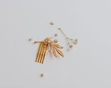 Vintage flower comb with delicate golden leaves
