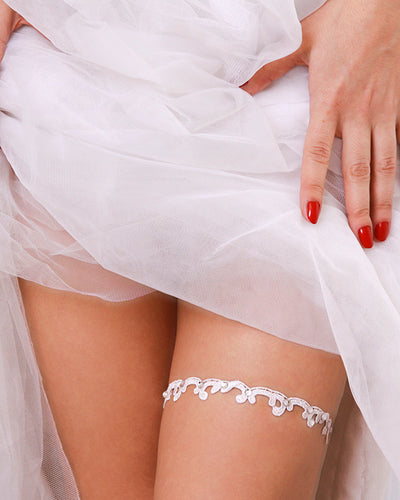 Delicate lace garter embellished with Swarovski crystals