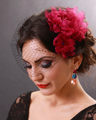 Boho black birdcage veil with fuchsia amaranth flowers