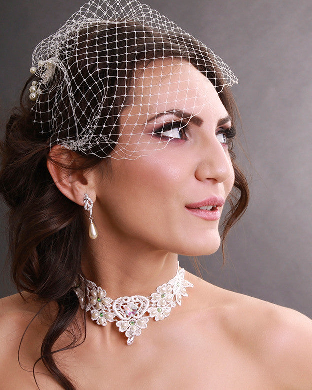 Delicate mini bridal birdcage veil embellished with ivory pearls