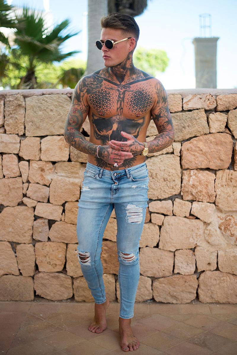 light blue Sinners Attire ripped and repaired jeans
