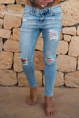Sinners Attire ripped and repaired jeans in light blue