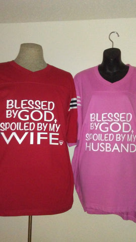 "His and hers ""Blessed by God"" shirts"
