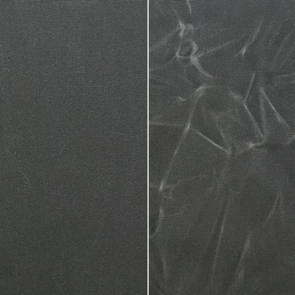 Load image into Gallery viewer, Fabric Funhouse Waxed Canvas in color Charcoal Grey, left side shows fabric smooth and right sized shows the appearance of creases once used