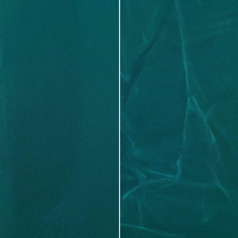 Fabric Funhouse Waxed Canvas in color Mermaid Teal, left side shows fabric smooth and right sized shows the appearance of creases once used