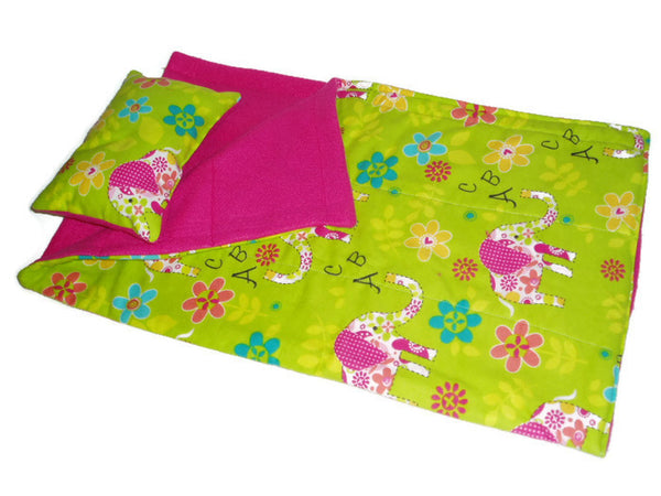 Bright colorful sleeping bag that fits American girl dolls with a flower and elephant print.