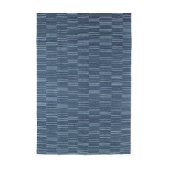 Broekn Stripe Rug by Oliver Yaphe, shades of blue in a stacked stripe pattern