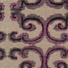 Detail of Amped Up Rug with a large curlie cue design in shades of  purple and bright pink on an ivory field.