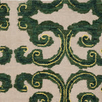 Detail of Amped Up Rug with a large curlie cue design in shades of  green and bright yellow on an ivory field.