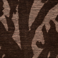 Detail of Capri Rug with a large abstract design shades of brown over varied stried lighter color background
