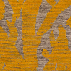 Detail of Capri Rug with a large abstract design shades of yellow over varied stried lighter neutral color background