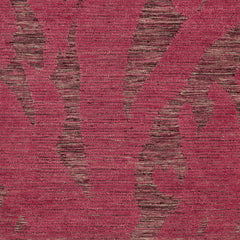 Detail of Capri Rug with a large abstract design shades of pink over varied stried lighter color background