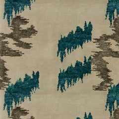 Detail of Stepping Stones rug featuring an organic jagged linear design in silver and teal on an ivory ground