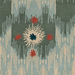 Detail of Estrella Rug in Lichen features a painterly abstract ikat in shades of cyan and seaglass blue and ecru with star shaped accents in coral and teal