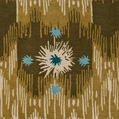 Detail of Estrella Rug in Lichen features a painterly abstract ikat in shades of olive and ecru with star shaped accents in cyan and teal