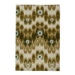 Estrella Rug in Lichen features a painterly abstract ikat in shades of olive and ecru with star shaped accents in cyan and teal