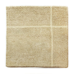 Handknotted Carve rug sample in tan natural colors with fringe detail