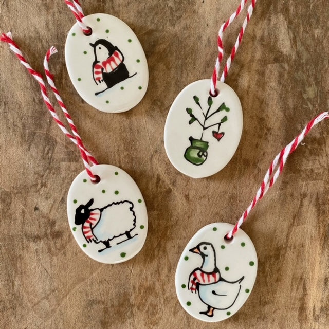 Hand painted ceramic oval decorations by Paisley & Co
