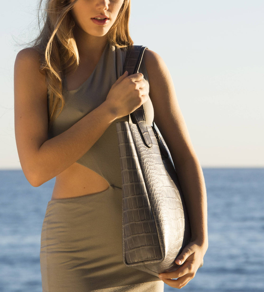 Grace Van Dien holding a grey alligator tote. Alligator hides from the Hermes tannery. Entirely hand sewn in Malibu, CA by Ben Hogestyn