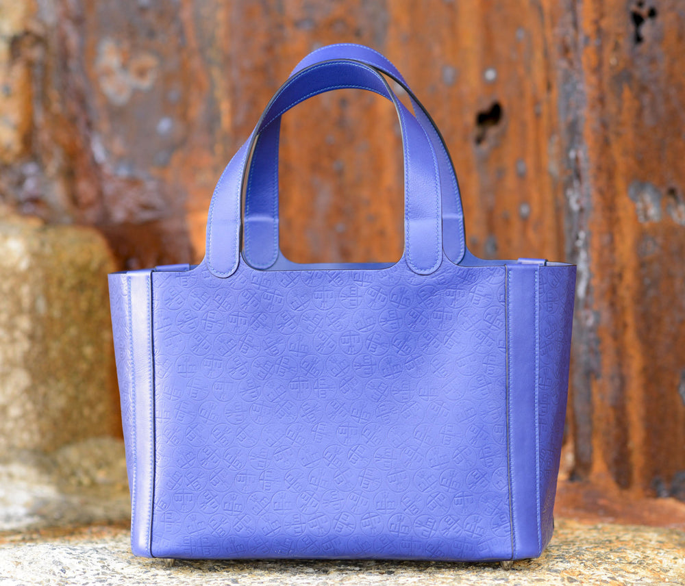 """Rachael"" tote in electric blue. Leather from the Hermes tannery. With all-over embossed monogram of the clients initials. Entirely hand sewn in Malibu, CA by Ben Hogestyn"