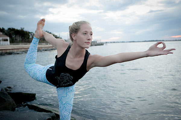 Katie Loftus Dancers Pose in Cerulean Seascpae Leggings for Apeiron Yoga