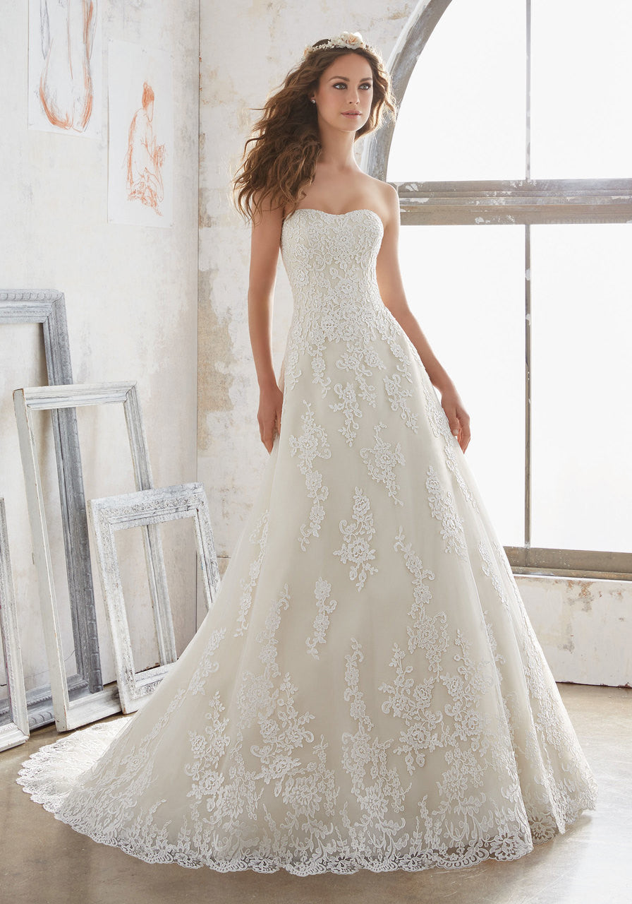 4491 Lace Appliques on Net Adorn This Classic A-Line Bridal Gown