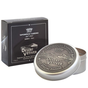 Desert Vetiver – Shaving Soap 150g Special Edition shaving soap scented with a Vetiver-inspired fragrance, with the addition in formula of Desert Date oil for a moisturizing and firming effect.  Scent Description A composition with warm and enveloping notes. The blend of Elemi, Incense, Orange and Artemisia flare up in the flowery, peppery, spicy heart. A multifaceted sillage of Black Pepper, Juniper Berries, Oregano and Lavandin swarms towards an elegant woody
