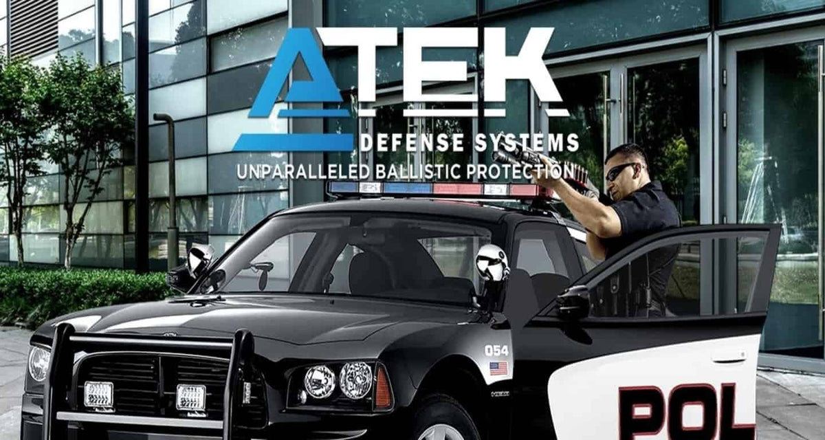 ATEK logo with police officer holding a weapon behind a squad car