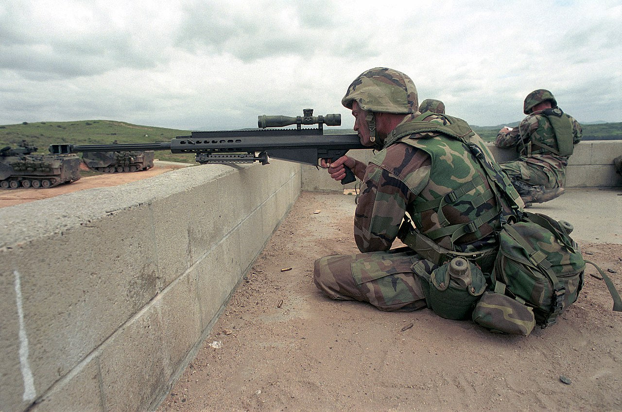 A USMC sniper wearing an IBA vest while practicing with an M82A3 anti-materiel rifle