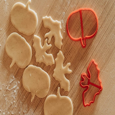 Halloween-shaped cookie dough and cookie cutters