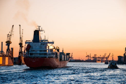 A cargo ship in the middle of a port