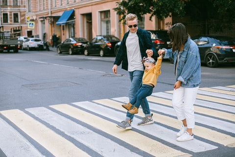image of family walking on the street