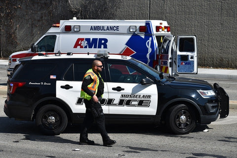 police officer and ambulance