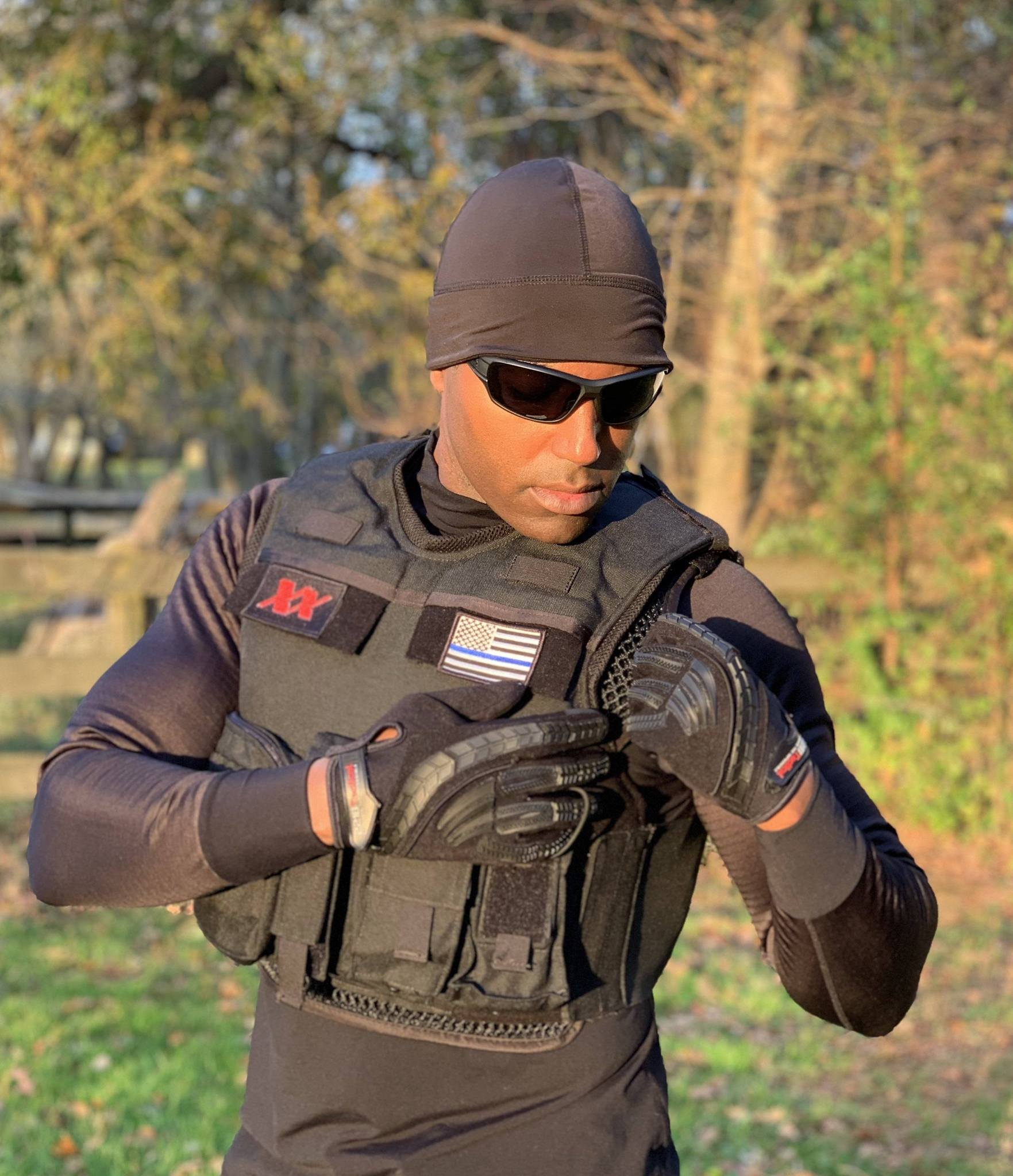 Man wearing tactical gear and EQUINOXX WATCH CAP BEANIE
