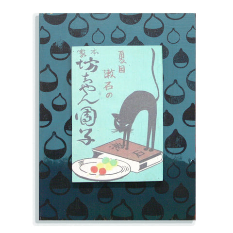 Black arched kitty on blue