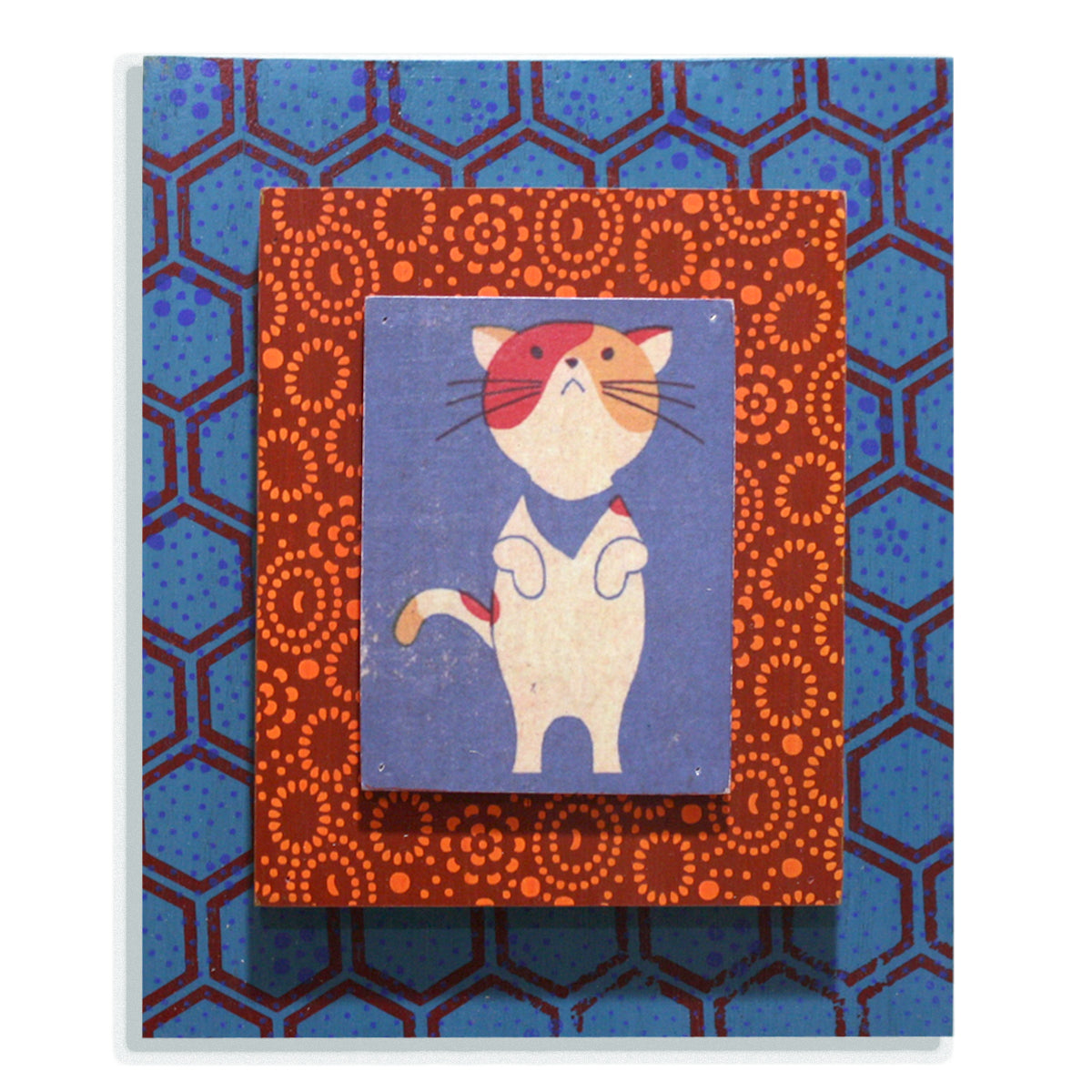 Begging cat on blue and red