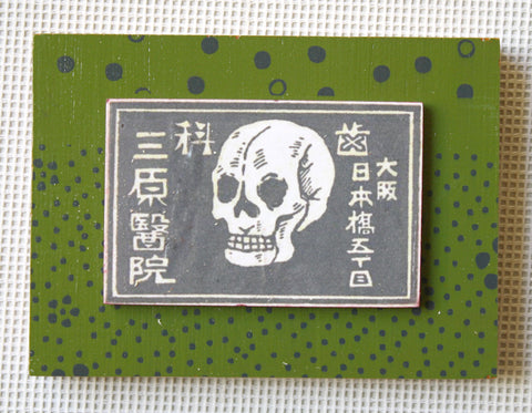 Skull on green with grey dots