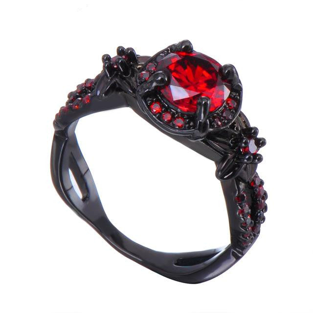 Black ring with red stone