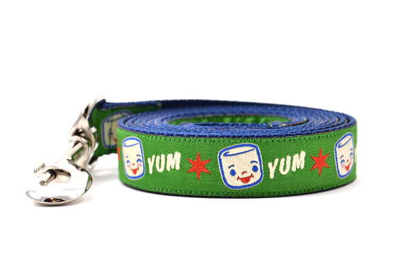 Large Green dog leash with Marshall the Marshmallow.  Marshall is shown smiling and giggling. The design also includes the word YUM.
