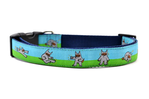 Dog collar that is half blue and half green with a dog dressed in a Ninja Suit.  The dog is shown in various tai chi positions.
