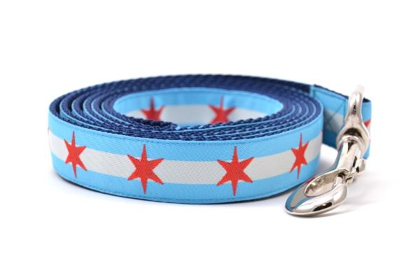 Large dog leash with two light blue stripes and one white stripe and red six pointed stars - representing the Chicago Flag.