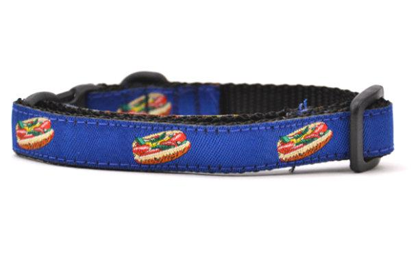 One navy cat collar with design that depicts chicago style hot dog.