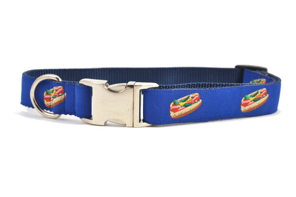 Large navy dog collar with metal clasp with design that depicts the Chicago Style Hot Dog.