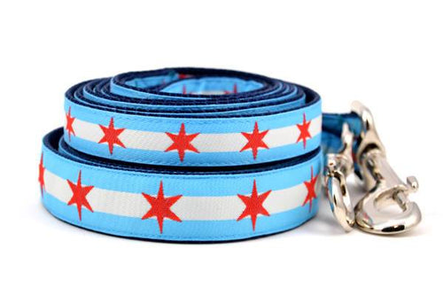 Stack of two dog leashes with two light blue stripes and one white stripe and red six pointed stars - representing the Chicago Flag.