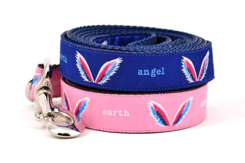 Picture of two dog leashes stacked.  One is pink one is navy with a design that depicts angel wings and words earth angel.