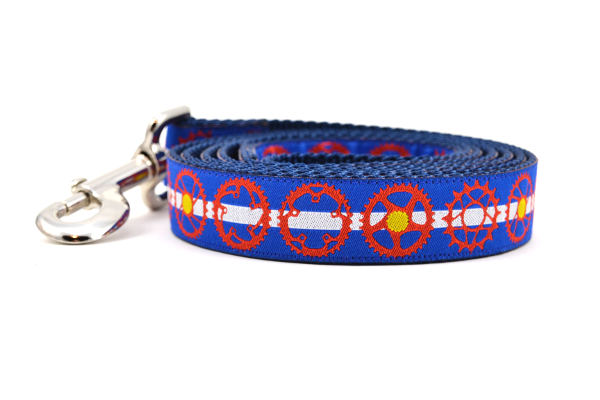 Large dog leash blue and white stripes and red bicycle sprockets - some filled in with yellow dots - representing the Colorado State Flag.